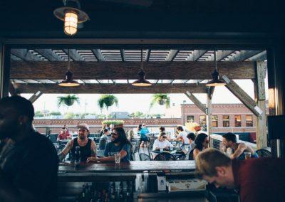 guys-talking-at-rooftop-bar